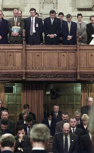 Former U.S. governor Thomas Ridge, director of U.S. Homeland Security, and United States Ambassador to Canada Paul Cellucci stand in the visitors gallery in the House of Commons in Ottawa Tuesday Dec. 11, 2001, and bow their heads along with members of Parliament for a moment of silence in honour of those kiilled in terrorist attacks in the United States on September 11, 2001. (CP PHOTO/Fred Chartrand)