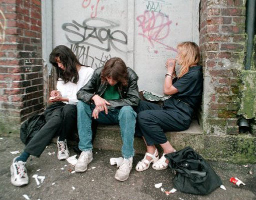 (XVCR103)VANCOUVER, B.C., July 15--Three unidentified drug users sit in an alley in Vancouver on Tuesday. The rate of HIV infection among drug users in Vancouver's downtown Eastside is now the highest of any country in the Western  world according to the latest provincial report. It states that between 18% and 20% of this group will become HIV positive this year alone, adding to the 23%   already infected. The Killing Fields Campaign held a rally in Vancouver on Tuesday morning to highlight the problem. (CP PHOTO) 1997 (str-Nick Procaylo)