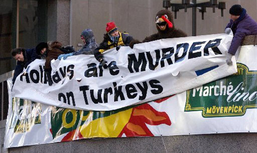(MTL103)MONTREAL, DEC.22--Members of an animal rights group unfurl a banner reading