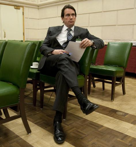 Quebecor Media Inc. CEO Pierre Karl Peladeau reads over his notes on Parliament Hill in Ottawa, Thursday October 20, 2011 as he waits to appear at committee on Access to Information, Privacy, and Ethics hearing witness on access to information dispute and and the resulting court actions concerning the CBC. THE CANADIAN PRESS/Adrian Wyld