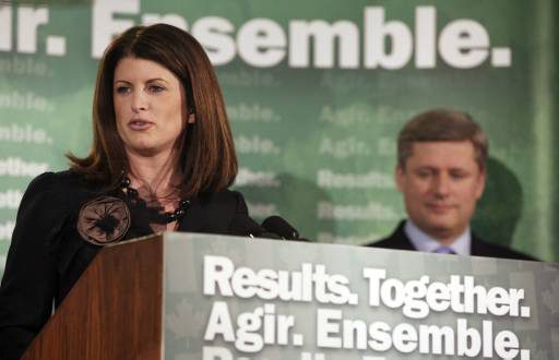 Minister of Intergovernmental Affairs and Western Economic Diversification, Rona Ambrose, introduces Prime Minister Stephen Harper, right, in Edmonton, on Thursday March 8, 2007. The Prime Minister announced  $155.9 million in federal founding to help reduce greenhouse emissions by pumping tons of carbon dioxide deep underground. (CP PHOTO/John Ulan)