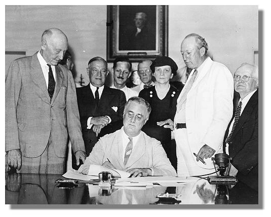 Surrounding president Franklin D. Roosevelt as he signs the Social Security Act (from left) representative Robert Doughton, senator Robert Wagner, secretary of labor Frances Perkins, senator Pat Harrison, and representative David L. Lewis.