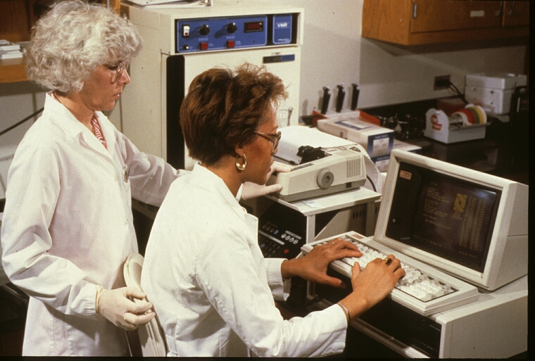 Technicians reading results of ELISA HIV test