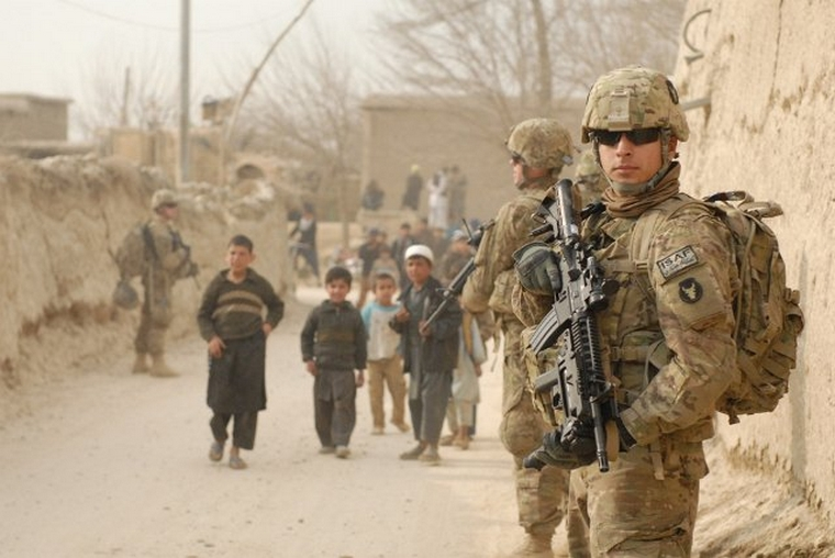 Army Spc. Carlos R. Hansen and fellow soldiers patrol the villages in the Bagram Security Zone. ©U.S. Army
