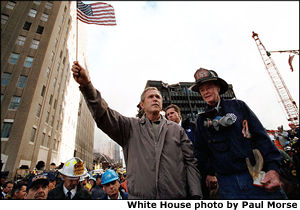 President George W. Bush standing upon the ashes of the worst terrorist attack in the United States.