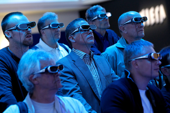 IFA Technology Fair: BERLIN - SEPTEMBER 03:  Visitors wearing 3D glasses watch a presentation on 3D televisions at the Panasonic stand at the 2010 IFA technology and consumer electronics trade fair at Messe Berlin on September 3, 2010 in Berlin, Germany. The 2010 IFA will be open to the public from September 3-8.  (Photo by Sean Gallup/Getty Images)