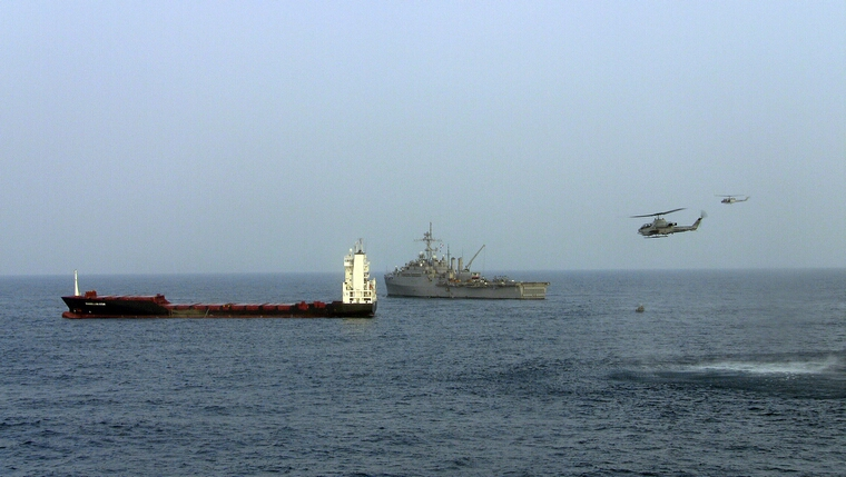 U.S. Navy Boards Ship Taken By Pirates: GULF OF ADEN - SEPTEMBER 9: In this handout from the U.S. Navy, the U.S. Navy amphibious transport dock ship USS Dubuque (R) and U.S. Marine Corps Cobra attack helicopters conduct a raid on the M/V Magellan Star after it was attacked and boarded by pirates September 9, 2010 in the Gulf of Aden. According to reports the U.S. Marines boarded the German owned ship after pirates had captured it on September 8, off the Somalia coast. It marks the first time that U.S. forces near Somalia have boarded a vessel taken by pirates. (Photo by William Farmerie/U.S. Navy via Getty Images)