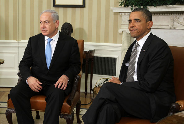 President Obama And Netanyahu Speak To Press After White House Meeting: WASHINGTON - MAY 20:  U.S. President Barack Obama (R) and Israeli Prime Minister Benjamin Netanyahu (L) prepare to make statements after their meeting May 20, 2011 in the Oval Office of the White House in Washington, DC. The two leaders were expected to discuss President Obama's suggestion of Israel reverting to the pre-1967 borders as the base for Israel and Palestine to negotiate a two-state solution.  (Photo by Alex Wong/Getty Images)