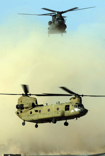 In this photograph taken on March 30, 2011, two US army Chinook helicopters land at Kandahar airfield in southern Afghanistan.  A helicopter from the NATO-led foreign force in Afghanistan has crashed during an anti-Taliban operation, an Afghan official said August 6, 2011, adding there were foreign troop casualties. The helicopter came down late August 5 in a Taliban-infested district of the eastern province of Wardak, southwest of Afghan capital Kabul, said provincial spokesman Shahidullah Shahid. An eyewitness told AFP that the helicopter had crashed as it was trying to take off after landing on the roof of a Taliban commander's home during a firefight. AFP PHOTO/Peter PARKS/ FILES (Photo credit should read PETER PARKS/AFP/Getty Images)