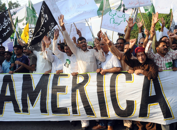 Pakistanis shout anti-US slogans during: Pakistanis shout anti-US slogans during a protest rally outside the US consulate to condemn US threats in Lahore on September 28, 2011. The United States stepped up pressure on the Pakistani government, saying it must clamp down on the Haqqani network blamed for the attack on the US embassy in Kabul. Last week, the outgoing top US military officer, Admiral Mike Mullen, bluntly accused Pakistan of 