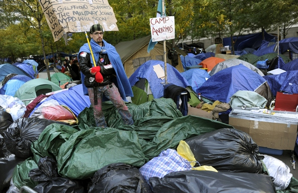 Demonstrators with 'Occupy Wall Street' continue their protest at Zuccotti Park in New York on November 4, 2011. The encampment in the financial district of New York City is now in its second month. The demonstrators are protesting bank bailouts, foreclosures and high unemployment. AFP PHOTO / TIMOTHY A. CLARY (Photo credit should read TIMOTHY A. CLARY/AFP/Getty Images)