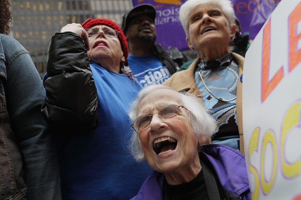 CHICAGO, IL - NOVEMBER 07:  Senior citizens protest against cuts to federal safety net programs, including Social Security, Medicare, and Medicaid on November 7, 2011 in Chicago, Illinois. About 40 of the demonstrators were arrested, cited, and released after they blocked a downtown intersection and refused police orders to move.  (Photo by Scott Olson/Getty Images)