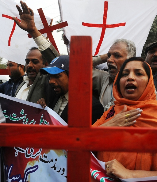 Pakistani Christians shout slogans during a protest in Lahore on November 28, 2011, against a NATO strike on Pakistan troops. Hundreds of Pakistanis called on Islamabad to break off its alliance with the United States and get out of the war on Al-Qaeda as protests against a lethal NATO strike pushed into a third day. Twenty-four Pakistani soldiers were killed in the cross-border attack by NATO helicopters and fighter jets. AFP PHOTO / ARIF ALI (Photo credit should read Arif Ali/AFP/Getty Images)