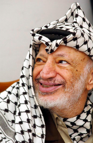 Yasser Arafat at his Ramallah Office 405067 01: Palestinian president Yasser Arafat smiles at his office May 7, 2002 in the West Bank city of Ramallah. Arafat was urged by several Palestinian groups to reject the end of the siege of the Bethlehem church, which may be seen as giving into Israel. (Photo by Getty Images)  -- Image Date: 07/05/2002  -- Image Date: 07/05/2002