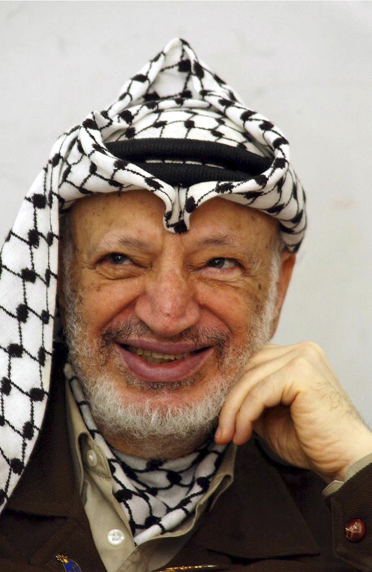 Palestinian leader Yasser Arafat smiles while in his office May 11, 2002 in the West Bank town of Ramallah. Israel's planned offensive against militants in the Gaza Strip has been put on hold. (Photo by PPO/Getty Images)