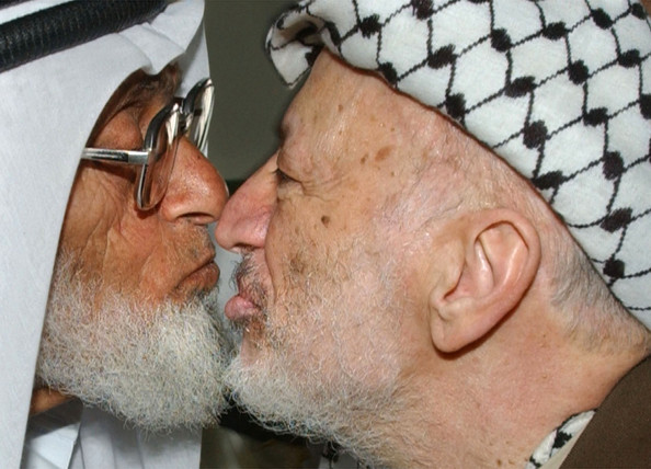 Arafat Visits Bethlehem 405267 05: Palestinian leader Yasser Arafat (R) kisses a supporter in the mosque off of Manger Square near the Church of the Nativity May 13, 2002 in the West Bank town of Bethlehem. Arafat travelled to the West Bank, his first around the region in six months after Israel lifted his travel ban. (Photo by Chris Hondros/Getty Images)  -- Image Date: 13/05/2002  -- Image Date: 13/05/2002