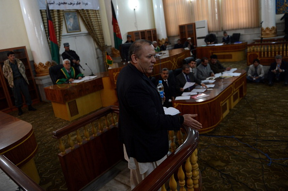 AFGHANISTAN-ECONOMY-BANK-CORRUPTION: Former Chairman of Afghanistan's Kabul Bank, Sher Khan Farnoud (C) speaks at a court in Kabul on March 5, 2013. A special court in Afghanistan has sentenced two senior executives to five years in jail for a multi-million-dollar fraud that caused the collapse of the Kabul Bank in 2010. Judge Shamsul Rahman Shams read out the verdicts and said the men must pay back money they gained from the sophisticated network of corruption in which cash was used to buy homes in Dubai, Britain, Switzerland and the United States. The bank's former chairman, Sher Khan Farnoud, and its former CEO Khalilullah Ferozi were both in court to hear the verdicts against them, along with some of the 20 other accused who were given sentences of between six months and four years.   AFP PHOTO/ SHAH Marai        (Photo credit should read SHAH MARAI/AFP/Getty Images)