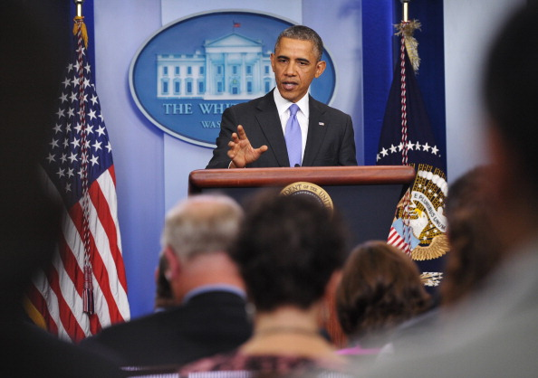 US-POLITICS-HEALTH-OBAMA: US President Barack Obama pauses as he speaks on the Affordable Care Act in the Brady Press Briefing Room of the White House on November 14, 2013 in Washington, DC. Obama said Thursday that Americans should be allowed to keep canceled health plans for an extra year as he acknowledged a