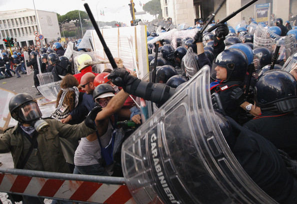 Anti-globalisation demonstrators clash w Anti-globalisation demonstrators clash with anti-riot police in front of  the Palazzo dei Congressi at the Intergovernmental Conference (IGC),  04 October 2003 in Rome. Riot police used teargas and batons to break up the protest by anti-globalisation demonstrators protesting at the EU leaders summit. AFP PHOTO AFP PHOTO Andreas SOLARO  (Photo credit should read ANDREAS SOLARO/AFP/Getty Images)  -- Image Date: 04/10/2003  -- Image Date: 04/10/2003