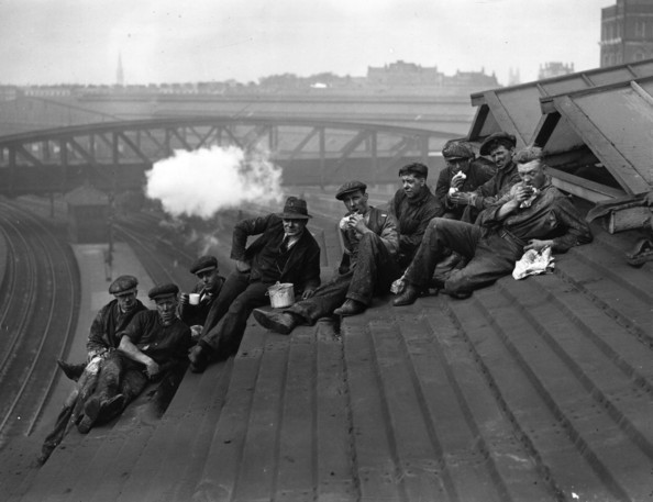 Roof Top Rest Workmen resting on the roof of Paddington station during their task of cleaning the glass panes.   (Photo by E F Corcoran/Getty Images)  -- Image Date: 13/10/1930  -- Image Date: 13/10/1930