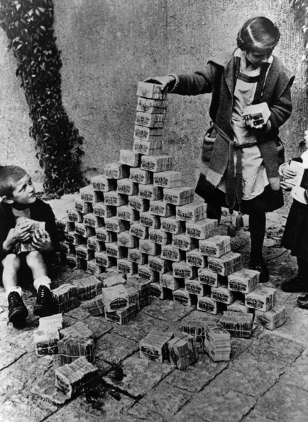 The Value Of Money Children using notes of money as building blocks during the 1923 German inflation crisis.   (Photo by Three Lions/Getty Images)  -- Image Date: 01/01/1923  -- Image Date: 01/01/1923
