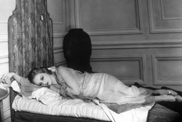 Bed Reverie Tallulah Bankhead (1902 - 1968), deep in thought, in a scene from 'Let Us Be Gay', at the Lyric Theatre, London.   (Photo by Sasha/Getty Images)  -- Image Date: 21/08/1930  -- Image Date: 21/08/1930