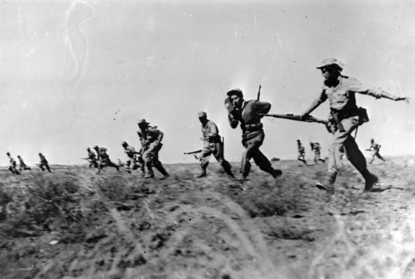 Israeli Attack Israeli infantry making a full assault on Egyptian forces in the Negev area of Israel during the War of Independence.   (Photo by Keystone/Getty Images)  -- Image Date: 23/10/1948  -- Image Date: 23/10/1948