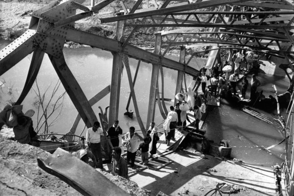 Arab Refugees Palestinian refugees crossing the remains of the Allenby Bridge over the River Jordan, blown up to prevent Israeli pursuit during the Six-Day War.   (Photo by Terry Fincher/Getty Images)  -- Image Date: 01/06/1967  -- Image Date: 01/06/1967