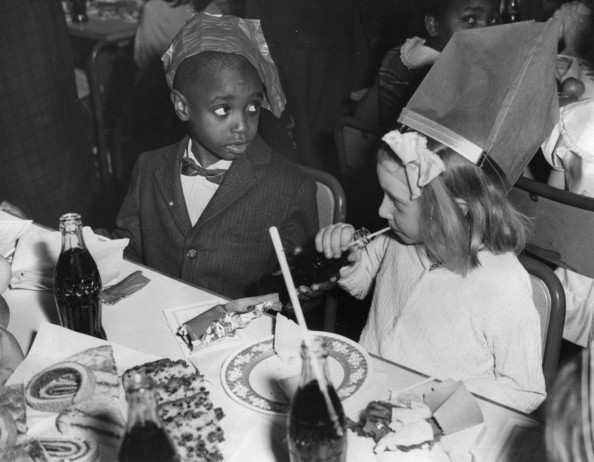 Christmas Party Guests at a Christmas party at Holland Park Comprehensive School, London, organised for children from diverse ethnic backgrounds.   (Photo by Douglas Miller/Getty Images)  -- Image Date: 23/12/1958  -- Image Date: 23/12/1958