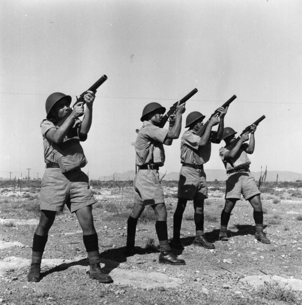 Mobile Riot Force Turkish recruits to the British Army practise firing tear gas guns at the height of the Greek-Cypriot struggle for Enosis.    (Photo by Keystone/Getty Images)  -- Image Date: 24/10/1955  -- Image Date: 24/10/1955