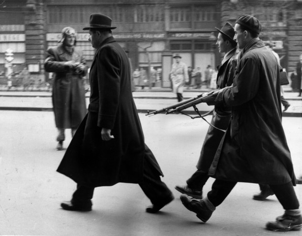 Question Time A member of the Hungarian secret police is marched off for questioning by patriots following the anti-communist uprising. The revolt ended with the Russian occupation of Budapest.  Original Publication: Picture Post - 8730 - Hungary's Last Battle For Freedom - pub.1956   (Photo by Jack Esten/Getty Images)  -- Image Date: 12/11/1956  -- Image Date: 12/11/1956