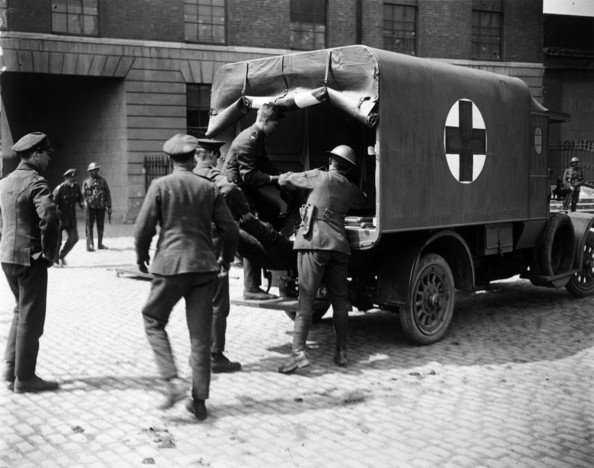 IRA Casualty An Irish Republican Army casualty is loaded into an ambulance during an IRA attack on Custom House, headquarters of the British Civil Service at Dublin.   (Photo by Hulton Archive/Getty Images)  -- Image Date: 01/05/1921  -- Image Date: 01/05/1921