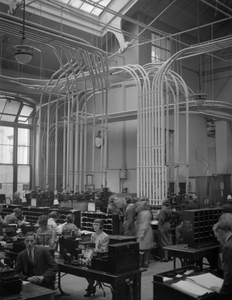 Telegraph Office The Central Telegraph Office in London, through which 50,000,000 telegrams pass every year, is manned by 3,000 staff who sit amid buzzing and humming machinery. Twelve miles of pneumatic tubes twist through the floors and ceilings of the galleries.   (Photo by Hudson/Getty Images)  -- Image Date: 05/10/1932  -- Image Date: 05/10/1932