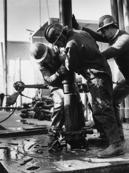 Roustabouts Oil rig labourers positioning a new length of pipe on a North Sea drilling rig, Transworld 61, which did exploratory drilling in Beryl Field, block 9/13 for Mobil.    (Photo by Central Press/Getty Images)  -- Image Date: 01/01/1975  -- Image Date: 01/01/1975