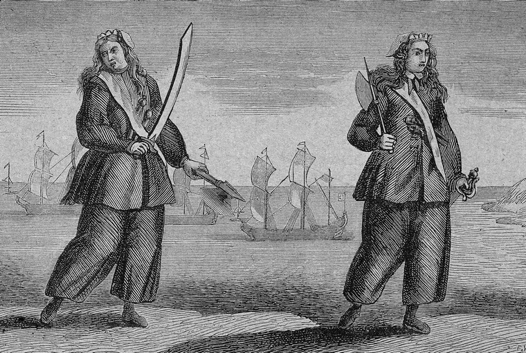 Engraving of female pirates Anne Bonny and Mary Read holding swords, circa 1730. (Hulton Archive/Getty Images)