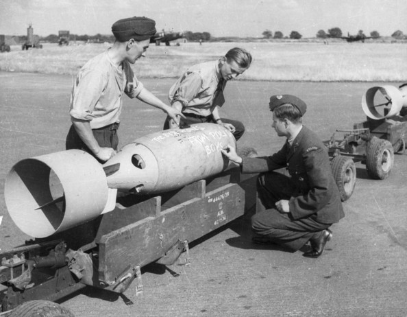 Polish Missile circa 1945:  Polish airmen writing a message on one of their missiles during World War II. The chalked writing reads 'The best wishes from Polish boys'.  (Photo by Hulton Archive/Getty Images)  -- Image Date: 01/01/1945  -- Image Date: 01/01/1945
