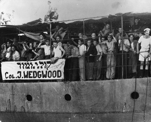 3rd July 1946:  Illegal Jewish immigrants crowd on to the deck of the 'Josiah Wedgwood' (Col J Wedgwood) on arriving in Haifa, Israel, on 27th June.  (Photo by Keystone/Getty Images)