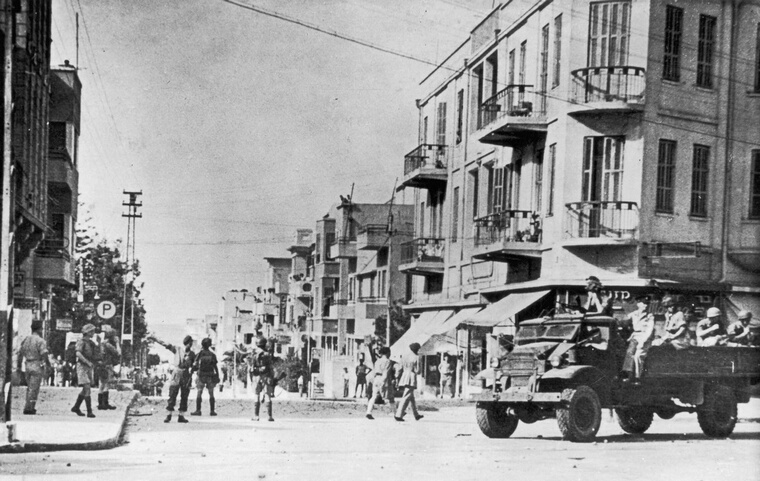 British Airborne Division troops clearing the streets of Tel Aviv, Palestine (now Israel) after being stoned by a mob, 27th November 1945. Rioting broke out over a statement on Palestine by British Foreign Secretary Ernest Bevin. (Photo by Keystone/Hulton Archive/Getty Images)