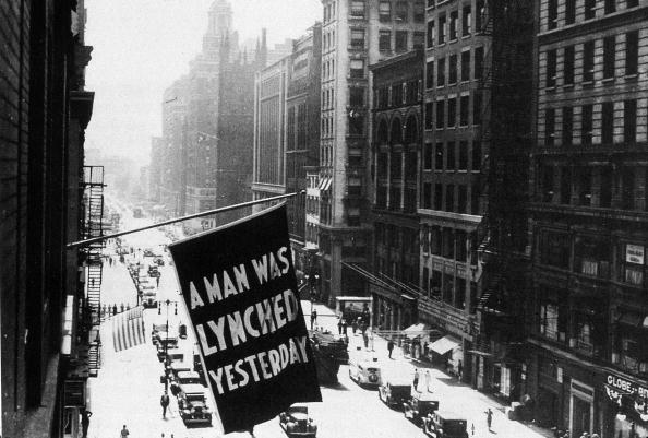 circa 1938:  A flag hanging outside the headquarters of the NAACP (National Association for the Advancement of Coloured People) bearing the words 'A Man was Lynched Yesterday'.  (Photo by MPI/Getty Images)  -- Image Date: 1/1/1938  -- Image Date: 1/1/1938