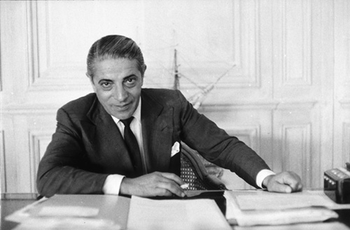 1958:  Greek shipping tycoon Aristotle Socrates Onassis (1906 - 1975) in his Monte Carlo office.  (Photo by Slim Aarons/Getty Images)