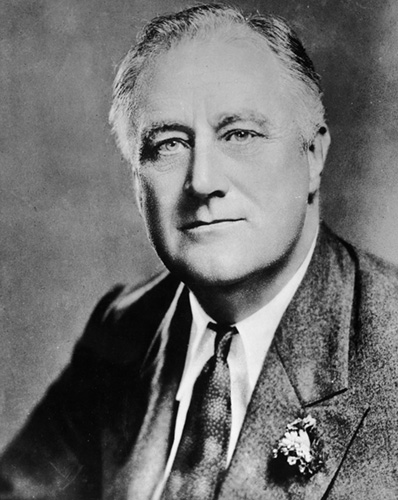 circa 1940:  Portrait of Franklin Delano Roosevelt (1882-1945), the thirty-second President of the United States. He served for an unprecedented four terms, from 1933 to 1945. Roosevelt, the former New York governor, led the country through the Great Depression with his social and economic policies of the New Deal, and saw the country through the global crisis of World War II.  (Photo by Hulton Archive/Getty Images)