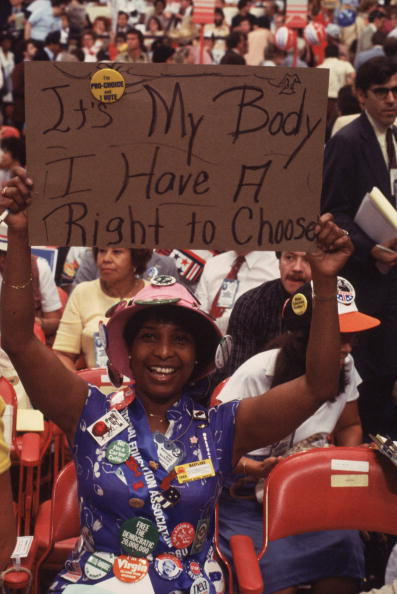 1980:  A woman holding up a sign reading 'Its My Body And I Have A Right To Choose' at a Democratic Convention in New York. She also wears a badge which reads 'I'm A Carter Cutie'.  (Photo by Keystone Features/Getty Images)  -- Image Date: 1/1/1980  -- Image Date: 1/1/1980