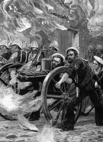 1882:  British Naval Brigade using a Gatling gun, which could fire 1200 shots a minute, to clear the streets of Alexandria during the war against Egypt in 1882.  (Photo by Rischgitz/Getty Images)