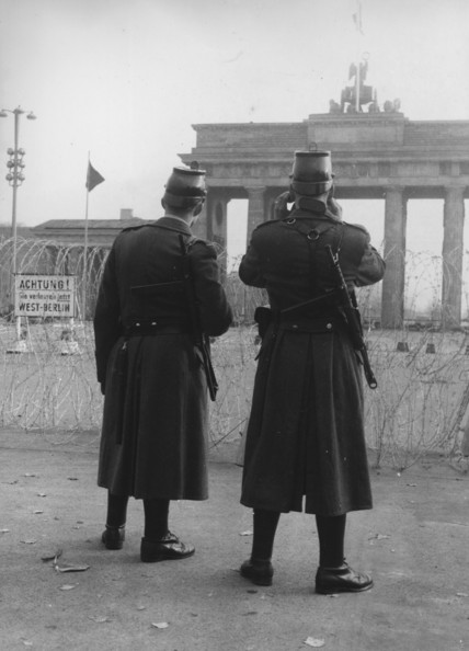 Border Guards circa 1947:  Two armed border guards standing at barbed wire fortifications in East Berlin.  The Brandenburg Gate is in the background.  (Photo by Central Press/Getty Images)  -- Image Date: 01/01/1947  -- Image Date: 01/01/1947