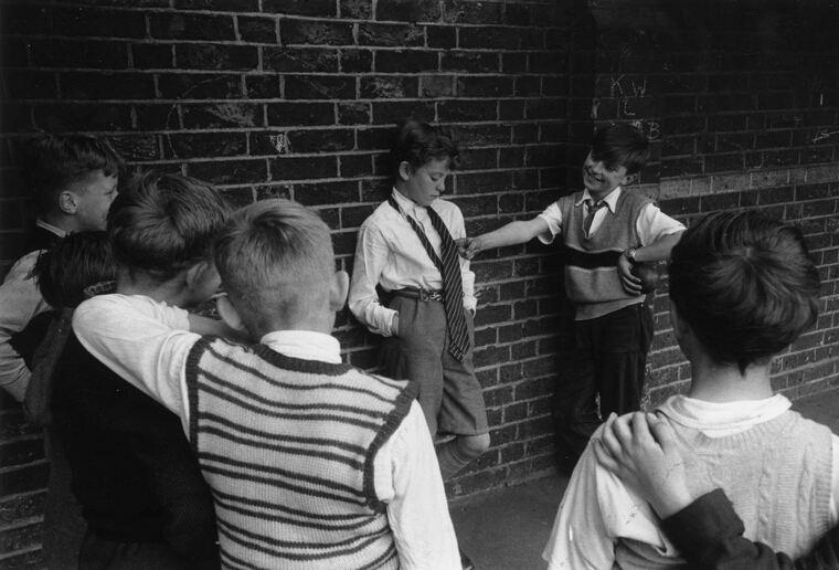 Bullying: 22nd June 1956: Children bullying a boy in a playground. Original Publication: Picture Post - 8798 - Doctor With A Camera - unpub. (Photo by Maurice Ambler/Picture Post/Getty Images)