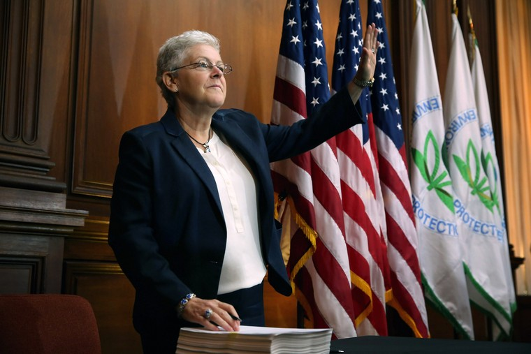 WASHINGTON, DC - JUNE 02:  U.S. Environmental Protection Agency Administrator Gina McCarthy waves before signing new regulations for power plants at EPA headquarters June 2, 2014 in Washington, DC. Bypassing Congress and using President Barack Obama's 'Climate Action Plan,' the new regulations will force more than 600 existing coal-fired power plants, the single largest source of greenhouse gas emission in the country, to reduce their carbon pollution 30 percent from 2005 levels by 2030.  (Photo by Chip Somodevilla/Getty Images)
