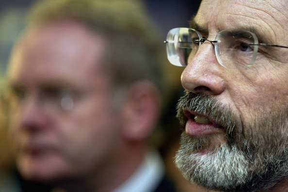 Photo Title: Sinn Fein Urges IRA To Embrace Politics Over Violence -- BELFAST, NORTHERN IRELAND - APRIL 6:  Sinn Fein Chief negotiator Martin McGuiness listens to Sinn Fein President Gerry Adams during a news conference in Conway Mill, April 6, 2005, in west Belfast, Northern Ireland.  Adams has today urged the IRA to fight through politics rather than violence. Mr Adams appealed to the group to seize the alternative to armed struggle and achieve their aims by 'political and democratic means'. (Photo by Paul McErlane/Getty Images)  Sinn Fein's Chairman Mitchell McLaughlin (R) looks at the statement in the hands of Party President Gerry Adams during a news conference in Conway Mill  -- Image Date: 06/04/2005  -- Image Date: 06/04/2005