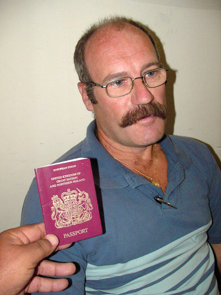 British Citizen Arrested In Iraq NAJAF, IRAQ - OCTOBER 4:  British national, Colin Peter, is seen with his passport on October 4, 2005 in the city of Najaf, Iraq. Peter and nine Iraqis were arrested on October 3 by Iraqi border security guards near Iraq's border with Saudi Arabia. According to reports, Peter is being held by the border guard awaiting a response from the British embassy. (Photo by Saad Serhan/Getty Images)  -- Image Date: 04/10/2005  -- Image Date: 04/10/2005