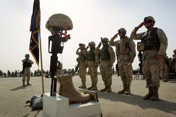 U.S. Troops Honor Fallen Comrade Near Dujail DUJAIL, IRAQ - OCTOBER 18:  U.S. Army soldiers salute during a memorial service for Sgt. Robert Tucker at a military base October 18, 2005 in Dujail, Iraq. Tucker, 20, from Cookeville, Tennessee, was killed by insurgents when a roadside bomb blew up his armored vehicle on October 13 near Dujail, just two weeks before the end of his 10-month deployment in Iraq. He was assigned to K-Troop, of the 278th Armored Cavalry Regiment, which patrols the area around Dujail. Saddam Hussein is scheduled to go on trial on October 19, for the death of 143 people from Dujail who he allegedly ordered killed in 1985 in revenge for an assassination attempt.  (Photo by John Moore/Getty Images)  -- Image Date: 18/10/2005  -- Image Date: 18/10/2005