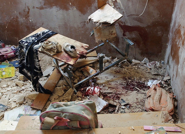 Rocket Hits a Public School in Baghdad BAGHDAD, IRAQ - OCTOBER 20: Children's school possessions lie dusty in a damaged classroom at Dujla primary school on October 20, 2005 in Baghdad, Iraq. A rocket landed in a public school in the high scale neighborhood of al-Mansour killing at least one child and wounding others. (Photo by Wathiq Khuzaie/Getty Images)  -- Image Date: 20/10/2005  -- Image Date: 20/10/2005